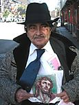 Man_with_jesus_picture_homeless_1